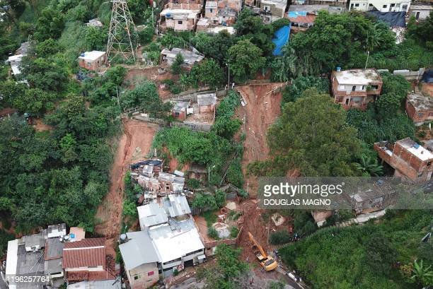 TOPSHOT Aerial view showing rescue workers searching for five victims who were buried by a landslide in Jardim Alvorada neighbourhood in Belo...