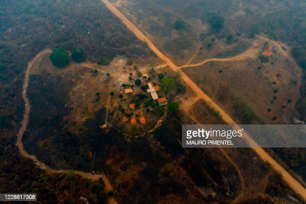 Aerial view showing the Jaguar Ecological Reserve Lodge, surrounded by burnt vegetation in the Pantanal, the world's largest tropical wetland, in...