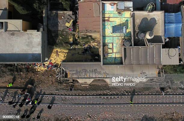 Aerial view showing the site where the last car of freight train derailed and hit two houses killing five people in the municipality of Ecatepec just...