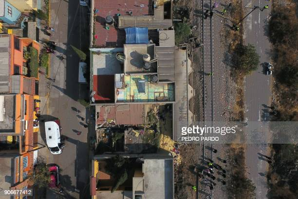 TOPSHOT Aerial view showing the site where the last car of freight train derailed hit two houses and killed five people in the municipality of...