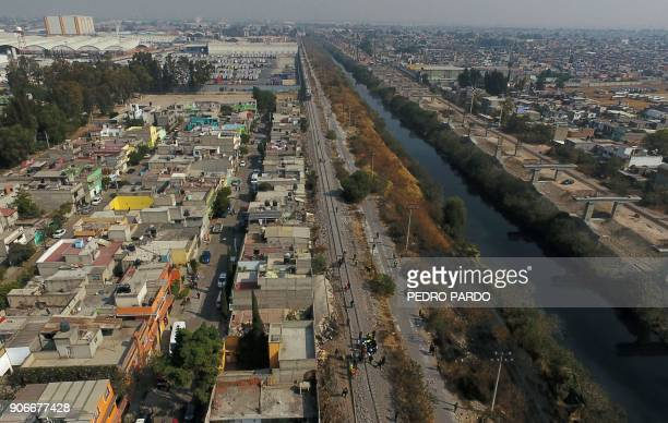 Aerial view showing the site where the last car of freight train derailed hit two houses and killed five people in the municipality of Ecatepec just...