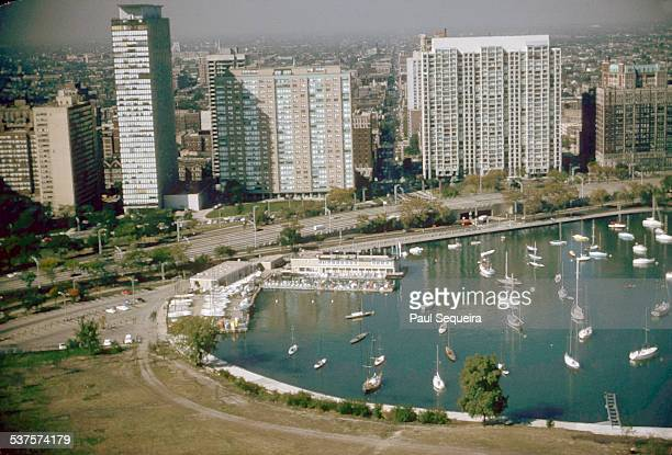 Aerial view showing the skyline along Lakeshore Drive with boats in Belmont Harbor Chicago Illinois 1980s