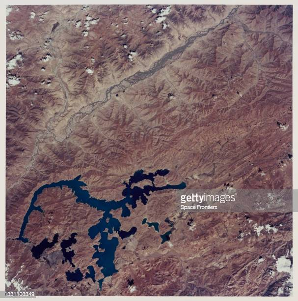 Aerial view showing the southern Tibetan Plateau in late summer without snow, and the large, irregular Lake Yamzho Yumco, which has the unusual...