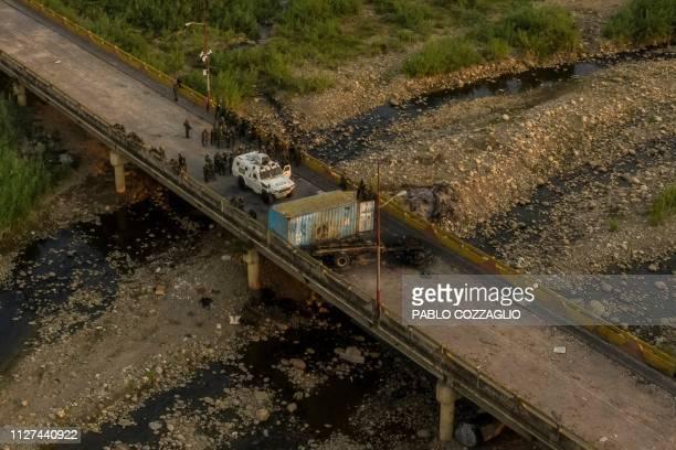 Aerial view showing Venezuelan security forces standing on the Simon Bolivar International Bridge over the Tachira river in San Antonio del Tachira,...