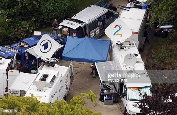 Aerial view shows a German television stations ARD trucks and Denmark's TV2 Sporten vehicles sparked in the TV media broadcasting area of the...