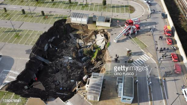 Aerial view shows a sinkhole in the Ospedale del Mare hospital car park, where people come for Covid-19 testing, on the outskirts of the city of...