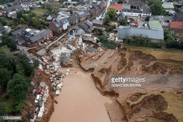 Aerial view shows an area completely destroyed by the floods in the Blessem district of Erftstadt, western Germany, on July 16, 2021. - The death...