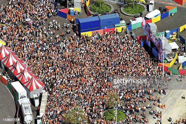 Aerial view shows people gathering during Queen's Day in Amsterdam on April 30 2012 AFP PHOTO / ANP / BRAM VAN DE BIEZEN netherlands out