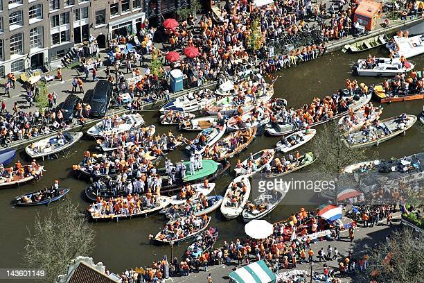 Aerial view shows people gathering on boats during Queen's Day in Amsterdam on April 30 2012 AFP PHOTO / ANP / BRAM VAN DE BIEZEN netherlands out