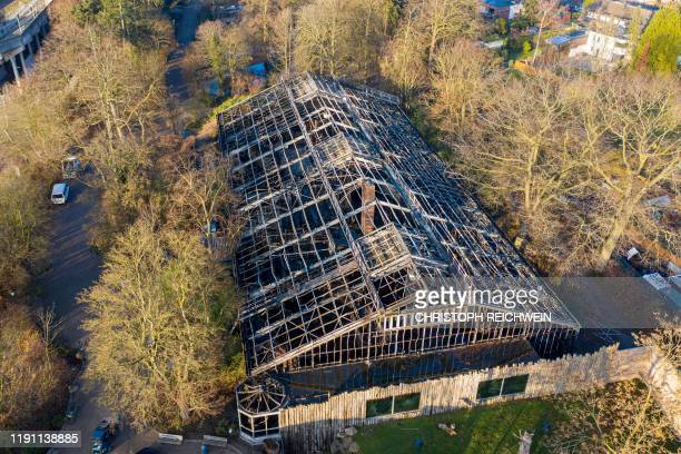Aerial view shows the burnedout monkey house of the zoo in Krefeld western Germany on January 1 2020 Fire ripped through the monkey house at Krefeld...