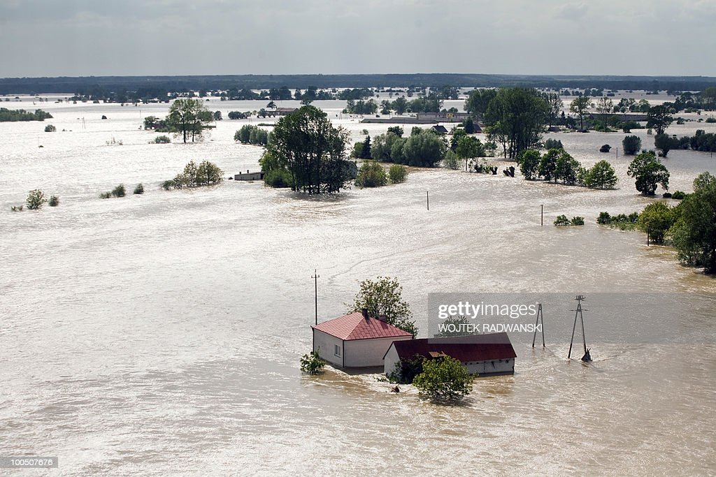 Aerial view shows the flooded area of Swiniary village in central Poland at Wisla river on May 25, 2010. Forecasters predicted intermittent rain and storms across Poland until the middle of the week as the flood crest moves north on the Vistula and the Oder among others.