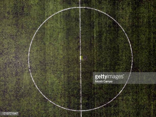 Aerial view shows the midfield circle of an empty football field The lockdown caused by the COVID19 coronavirus emergency banned all sports activities