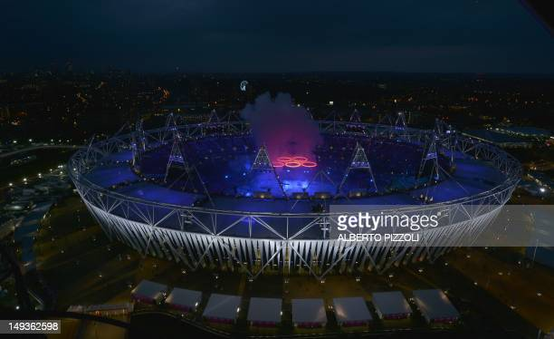 Aerial view shows the Olympic rings being raised in the Olympic Stadium during the opening ceremony of the London 2012 Olympic Games on July 27 2012...