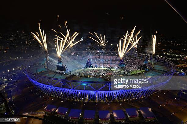 Aerial view shows the Olympic Stadium as fireworks explode during the opening ceremony of the London 2012 Olympic Games on July 27, 2012. AFP PHOTO /...