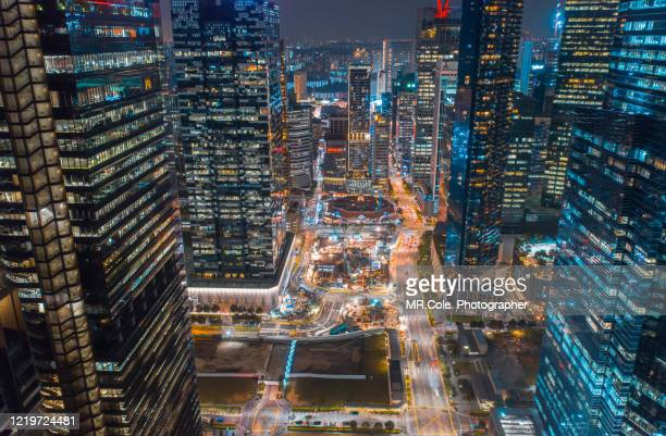 aerial view singapore city buildings in business district at night,financial economy, construction industry,or modern company organization concept - singapore stock pictures, royalty-free photos & images