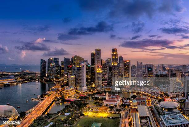 aerial view singapore marina bay at dusk - singapore city stock pictures, royalty-free photos & images