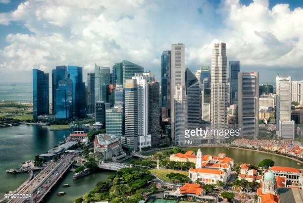 aerial view singapore marina bay at dusk - singapore cbd stock pictures, royalty-free photos & images