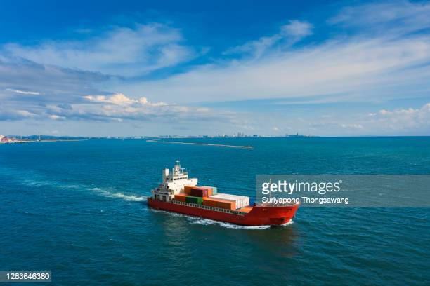 aerial view small container cargo ship carrier container for business logistics, import export, shipping or freight transportation. - quayside fotografías e imágenes de stock