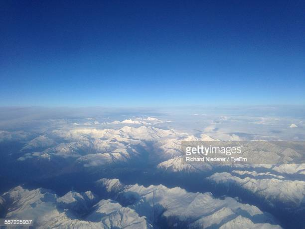 aerial view snowcovered mountains - clear sky stock pictures, royalty-free photos & images