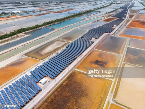 aerial view, solar cell, generate electricity at the salt farm for environmental conservation.. - ecosystem stock pictures, royalty-free photos & images