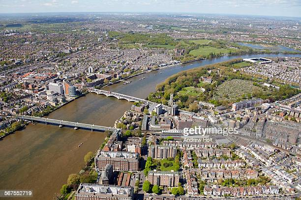 Aerial view South of the Thames river and Putney Bridge railway bridge and the  Kings road