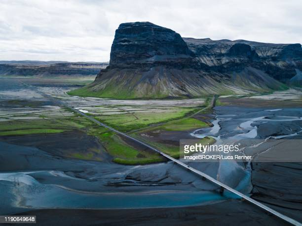 aerial view, straight road through volcanic landscape with rivers and mountains, iceland - lava plain stock pictures, royalty-free photos & images