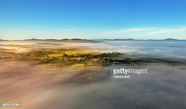 Aerial view, sunrise on foggy day above the fog