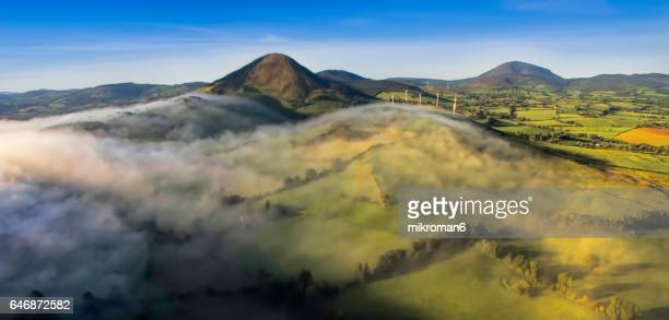 Aerial view, sunrise on foggy day over Tipperary mountains and fields