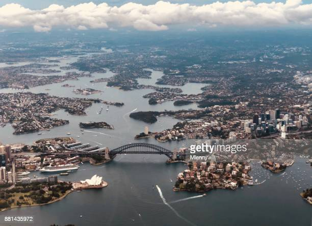 aerial view sydney with sydney harbour bridge - urban sprawl stock pictures, royalty-free photos & images