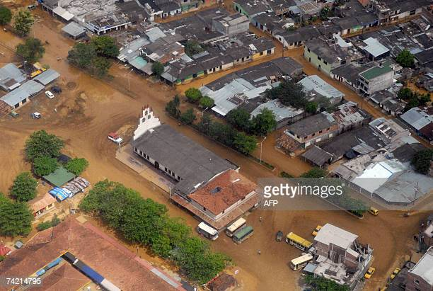 Aerial view taken 21 May 2007 of the village of Taraza department of Antioquia Colombia covered by mud after being hit by a landslideThe the seasonal...