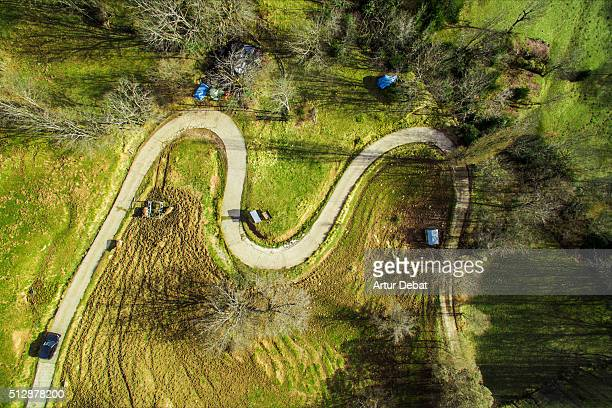 Aerial view taken by drone of a beautiful mountain road with nice curves and car in the Pyrenees mountains.
