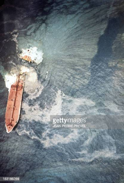 Aerial view taken in March 1978 of the wreck of the Liberian oil tanker Amoco Cadiz which ran aground near the small port of Portsall on the Breton...