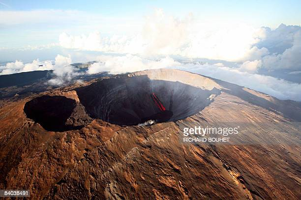 Aerial view taken on December 15 2008 on the French Indian island of La Reunion shows lava flowing out of Le Dolomieu crater of The Piton de la...