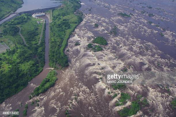 Aerial view taken on December 16 2013 in Inga shows the Inga 1 dam and Inga Falls on the Congo river The Democratic Republic of Congo and South...