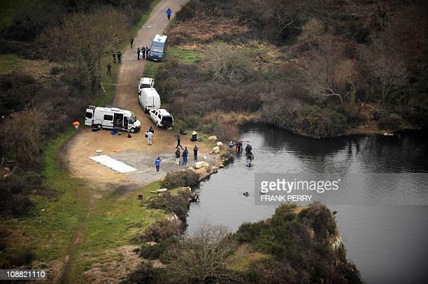 A aerial view taken on February 1 2011 shows policemen searching the body of 18yearold Laetitia Perrais in LavausurLoirePresident Nicolas Sarkozy was...