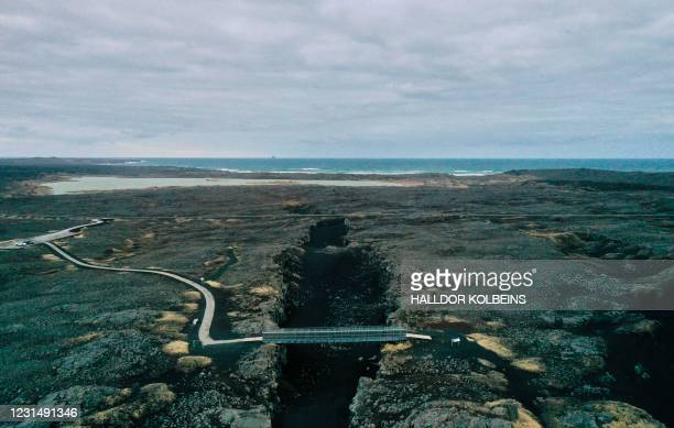 """Aerial view taken on February 28, 2021 shows the """"Bridge between Continents"""", a footbridge linking the Eurasian and North American tectonic plates,..."""