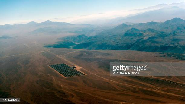 Aerial view taken on January 23 2015 of the newly finished PV Salvador solar plant near El Salvador in the Atacama desert northern Chile The...