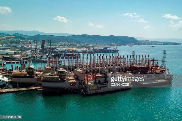 A aerial view taken on June 16 2020 shows Orca Sultan and Raif bey powerships docked in a shipyard at altinova district in Yalova Four years ago the...