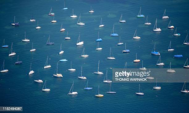 Aerial view taken on June 28, 2019 shows sailing boats lying at anchor on the Bodensee in Konstanz, southern Germany. / Germany OUT