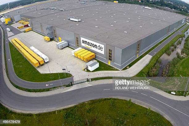 Aerial view taken on June 3 2014 shows the logistics centre of internet retail giant Amazon in Rheinberg western Germany Employees of the centre...