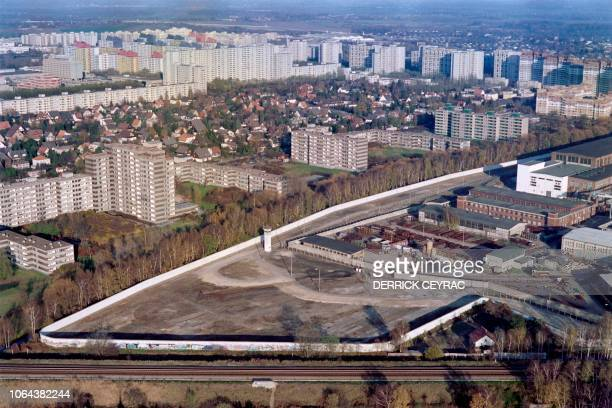 Aerial view taken on November 17, 1989 of the Berlin Wall along the french area in West Berlin and the no man's land marking the border between East...