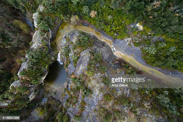 Aerial view taken with drone of a beautiful waterfall between the natural vegetation with nice pool in the Catalonia region.