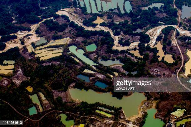 TOPSHOT Aerial view the Esperanca IV informal gold mining camp near the Menkragnoti indigenous territory in Altamira Para state Brazil in the Amazon...