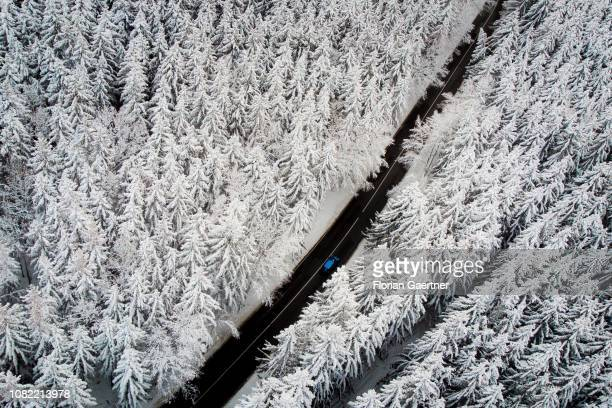 Aerial view to a road through a forest in winter on January 11 2019 in Reichenbach Germany