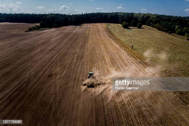 Aerial view to a tractor during its work on a dry field on September 06 2018 in Neuhardenberg Germany