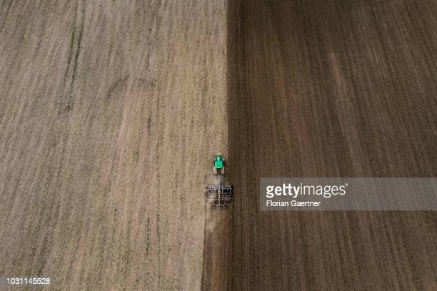 Aerial view to a tractor on a field on September 10 2018 in Wiesa Germany