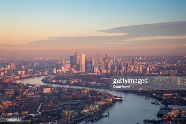 aerial view to canary wharf in london at sunset - central london stock pictures, royalty-free photos & images