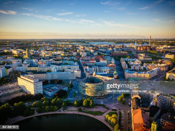 aerial view to hakaniemi district in downtown helsinki by sunset in summer - helsinki stockfoto's en -beelden