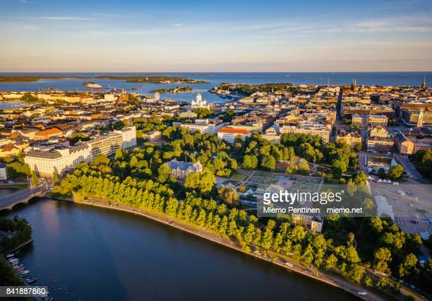 aerial view to kaisaniemi district and downtown helsinki by sunset in summer - helsinki stockfoto's en -beelden