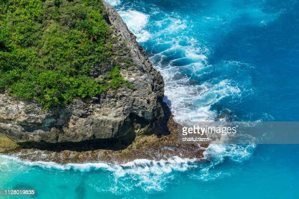 aerial view to ocean waves. blue water background. - shaifulzamri stock pictures, royalty-free photos & images